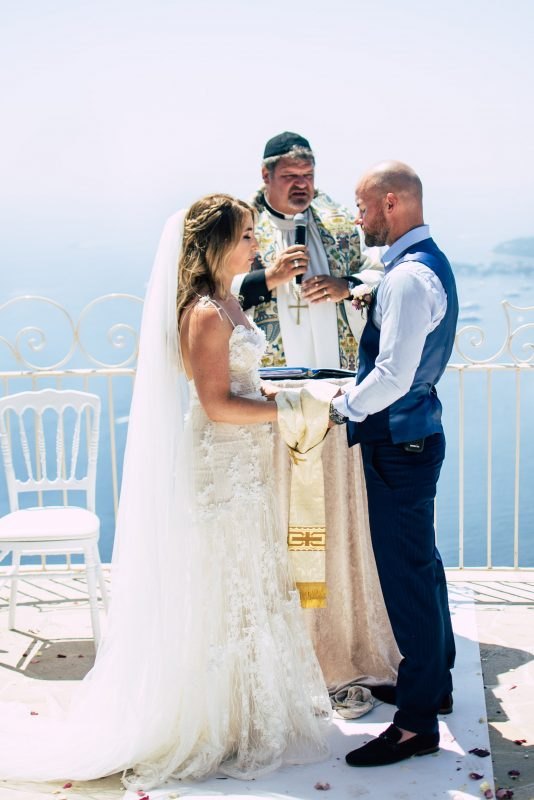 Couple in front of the sea during ceremony